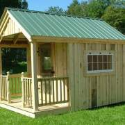 8x12 Garden Shed with porch railing with half newel posts, screen door and 4x2 hinged barn sash windows