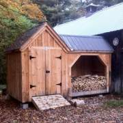 8x14 Vermont Gem - firewood storage shed with enclosed area placed on the left. Gray roof upgrade shown