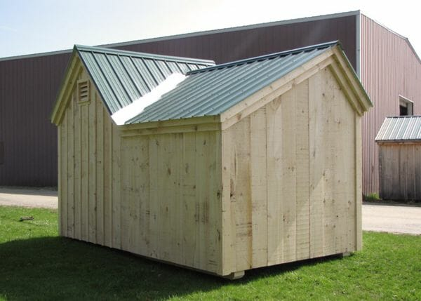 8x14 Vermont Gem firewood storage shed with an enclosure for tools and gardening equipment