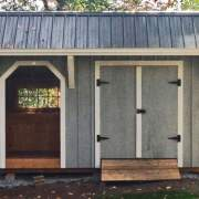 8x14 Weston Potting Shed painted gray with white trim and Charcoal Gray Roof