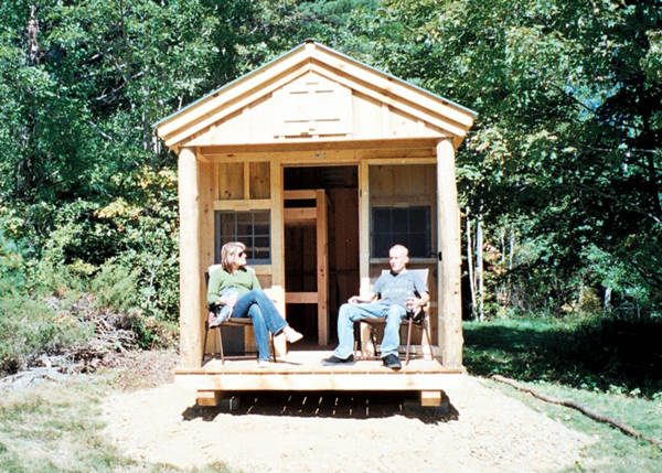 8x16 Bunkhouse - A happy couple enjoying the porch