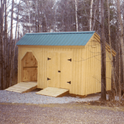 8x16 Weekender combination storage shed and firewood bin with an extra ramp