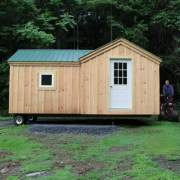 8x18 Heritage converted into a four season cabin with double pane awning window and nine-lite steel door