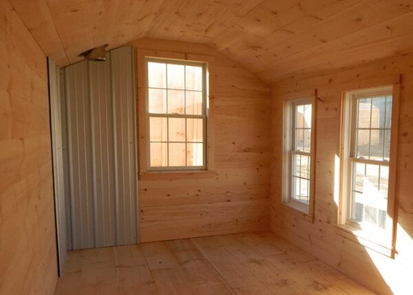 8x18 Heritage insulated interior with double pane windows and a heat shield and roof flashing for a woodstove