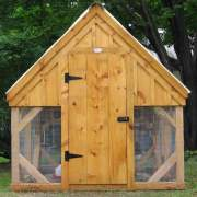 The coop includes hardware cloth siding, a single pine door with fastening hardware and a corrugated metal roof.