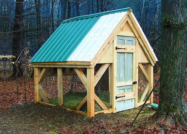 An 8x8 coop with an antique door installed in it