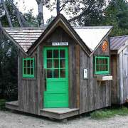 9x9 Bayside with cedar roof, green windows and green doors