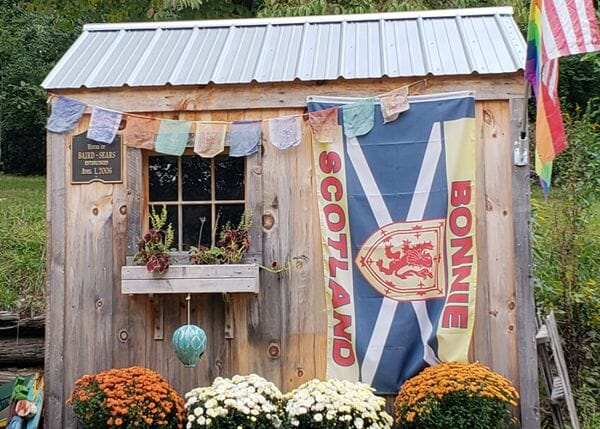 6x8 Nantucket small post and beam garden shed with gray metal roof and flower box