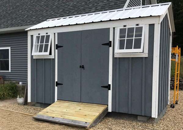 6x12 Nantucket - customized with alternative window placement, silver roof and paint