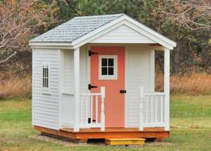 8x12 Nook post and beam cabin with clapboard siding, asphalt shingle roof and porch railing.