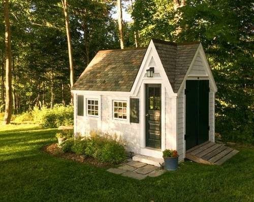 8x12 Dollhouse with Vermont quarried slate roof, clapboard pine siding and shutters.