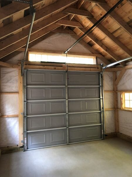 14x20 One Bay Garage with solid barn pine sheathing and client sourced vapor barrier