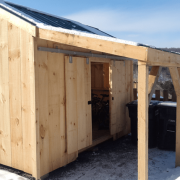10x14 New Yorker Option A shed with two sliding barn doors and an 8x14 overhang on the bearing wall