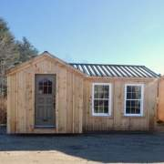 8x18 Heritage converted into a tiny house with antique door and insulated windows
