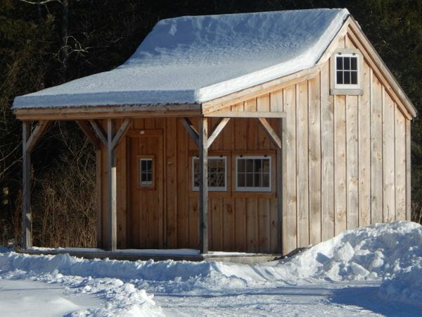 16x16 Homesteader with covered porch in the snow