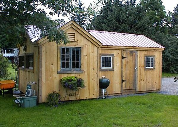 8x18 Heritage post and beam shed with extra windows and a brown metal roof