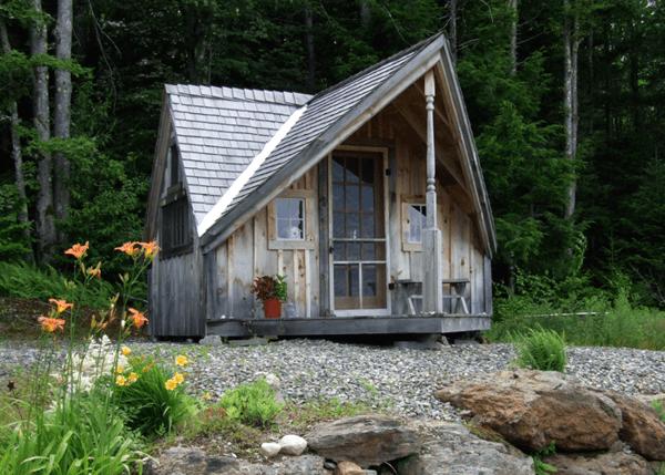 12x14 Writers Haven post and beam cottage with screen door, fifteen lite wood door and red cedar shingle roofing