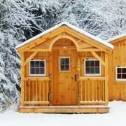 Post and beam cottage with 4x10 porch, porch railing and cedar sunburst arch