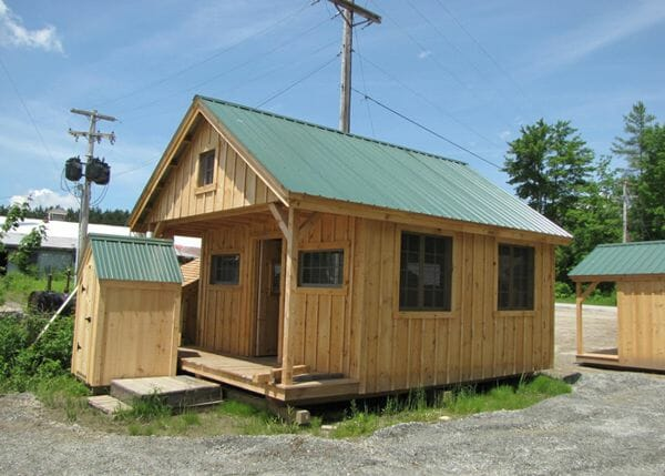 16x20 Vermont Cottage Option C includes a covered porch with a loft that extends ove rit.