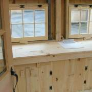 Bayside workshop interior with custom built in worktable with cabinets