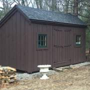 10x16 Saltbox painted brown with an asphalt shingle roof