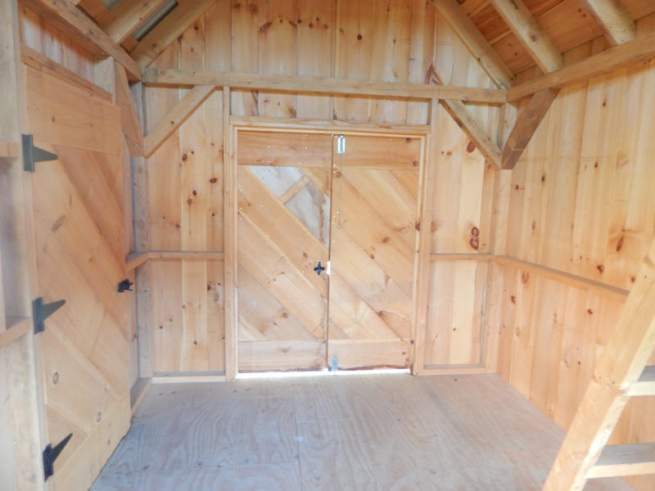 """5-0 JCS Built 2"""" thick Pine Double Doors on 10x16 Hobby House. Interior view. Black Turn Latch."""