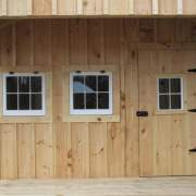 """2-8 JCS Built 2"""" thick Pine Single Door with 16""""x21"""" Fixed Window on 12x12 Potting Fort.  Exterior view."""