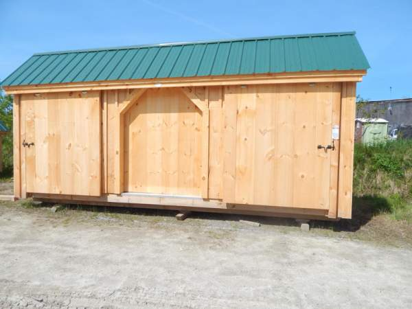 "5' JCS Built 2"" thick Pine Sliding Barn Door on 12x20 Three Sled Shed.  Exterior view.  Black Drop latch."