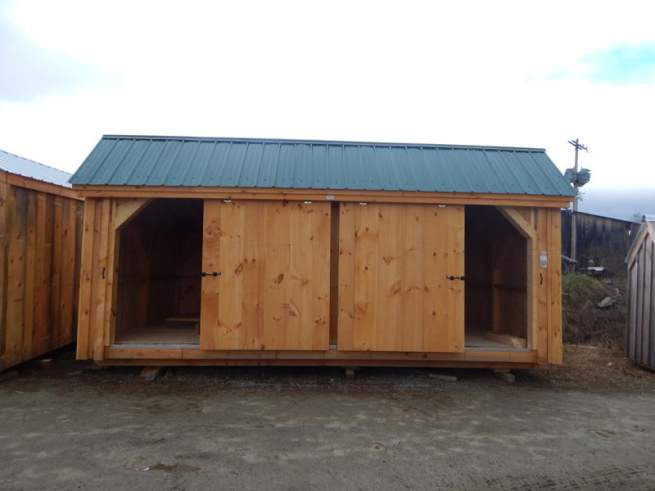 """5' JCS Built 2"""" thick Pine Sliding Barn Door on 12x20 Three Sled Shed.  Exterior view.  Black Drop latch."""