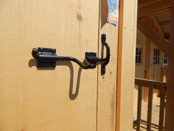 Heavy Duty Barn Door Drop Latch installed on sliding barn door on 12x20 Three-Sled Shed.