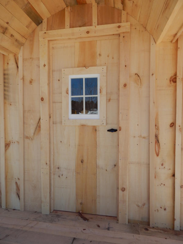 "2-8 JCS Built 2"" thick Pine Single Door with 16""x21"" Fixed Window on 12x20 Gibraltar. Exterior view. Black Turn Latch."