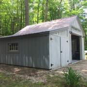 Enclosed overhang built with 4x4 Construction on a 14x20 One Bay Garage.