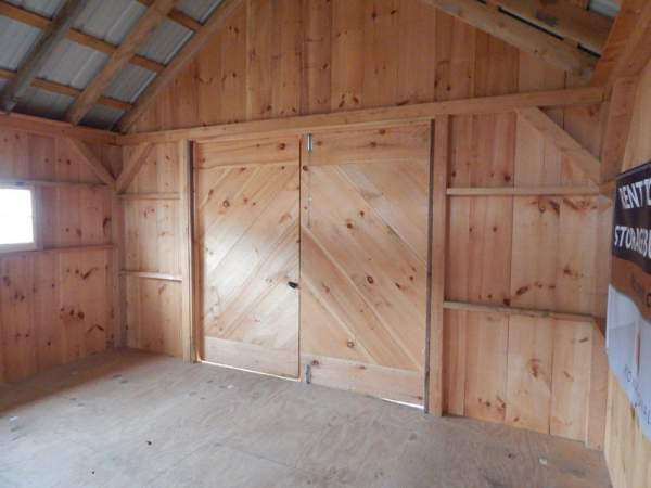 """6-0 JCS Built 2"""" thick Pine Double Doors on 16x24 Vermont Cottage B.  Interior view. Black Turn Latch."""
