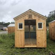 "Two 16"" x 21"" insulated windows are installed on either side of the door opening on this shed  build."