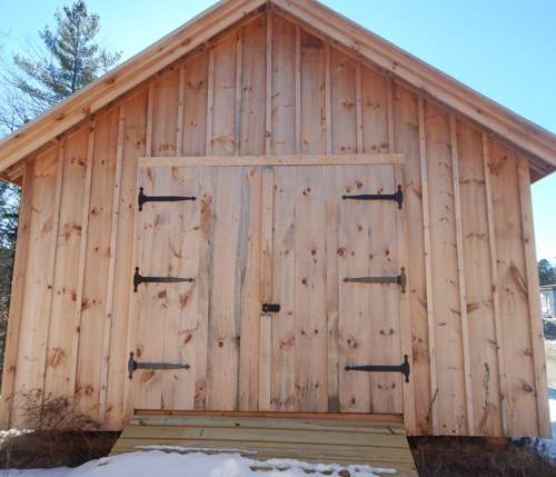 """6-0 JCS Built 2"""" thick Pine Double Doors on 16x24 Vermont Cottage B. Exterior view. Black Turn Latch and Strap Hinges."""