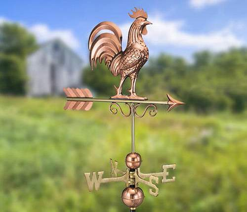 This decorative weathervane is made out of copper with brass directionals.