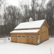 Enclosed overhang built with 8x8 Construction on a 20x30 Barn.
