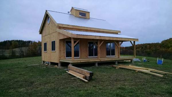 Porch kit for addition of covered porch using 8x8 Post & Beam construction.