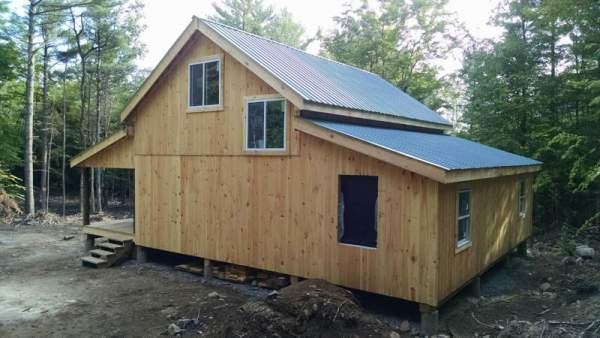 Enclosed overhang built with 8x8 Construction on a 20x30 Cabin.