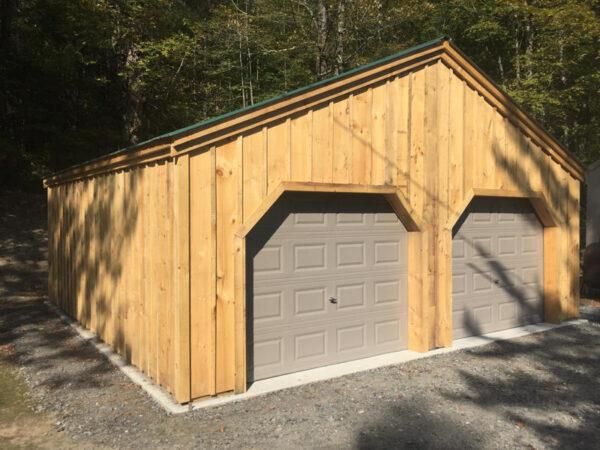 9x7 Overhead Garage Doors installed on 24x24 Simple Garage.
