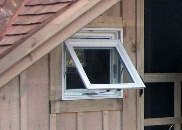 Awning Windows open out and up with the help of a handcrank. This one was installed in a four season Writers Haven cabin