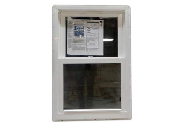 The 2x3 double hung insulated window slides up and down for ventilation.
