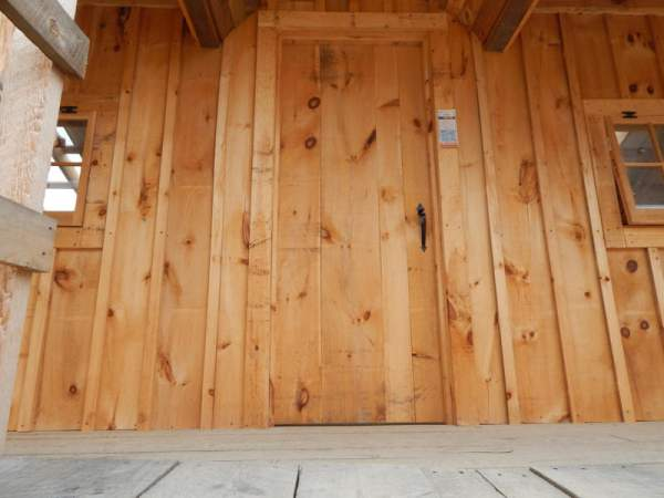 Our three-foot wide single door is constructed of rough sawn pine at our factory in Vermont.