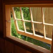 Hinged barn sash windows include a hook latch and eyelets that keep the window propped open, or secures when shut.