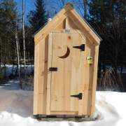 """2' JCS Built 2"""" thick Pine Single Door with Quarter Moon Cutout on 4x4 Working Outhouse.  Exterior view."""