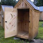 """2' JCS Built 2"""" thick Pine Single Door with Quarter Moon Cutout on 4x4 Outhouse.  Interior view. Black Turn Latch."""