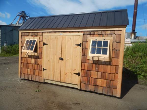 These solid wood double doors are constructed of rough sawn, rustic pine.