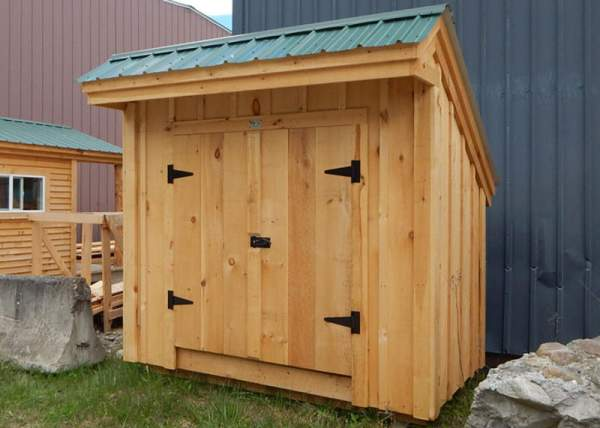 This small Saltbox storage shed is perfect for storing gardening tools or recycling