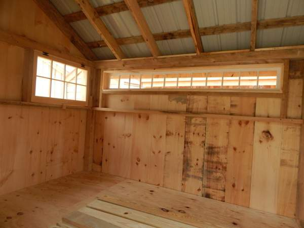 This extra wide fixed transom window was installed in a post and beam storage shed.