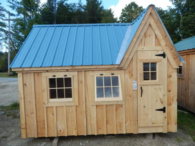 """2-0 JCS Built 2"""" thick Pine Single Door with 16""""x21"""" Fixed window on 8x12 Dollhouse.  Exterior view.  Black Thumb latch."""